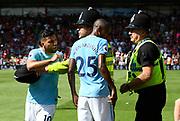 Sergio Aguero (10) of Manchester City confronting a police officer who was keeping him away from the celebrating crowd after Raheem Sterling (7) of Manchester City winning goalduring the Premier League match between Bournemouth and Manchester City at the Vitality Stadium, Bournemouth, England on 26 August 2017. Photo by Graham Hunt.