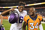 DENVER, CO - AUGUST 11:  Will Parks #34 of the Denver Broncos walks off the field with Cayleb Jones #16 of the Minnesota Vikings after preseason week 1 at Broncos Stadium at Mile High on August 11, 2018 in Denver, Colorado.  The Vikings defeated the Broncos 42-28.  (Photo by Wesley Hitt/Getty Images) *** Local Caption *** Will Parks; Cayleb Jones