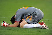 A dejected Doni lies on the ground after the UEFA Champions League shoot-out, Round of Last 16, Second Leg match between AS Roma and Arsenal at the Stadio Olimpico on March 11, 2009 in Rome, Italy.