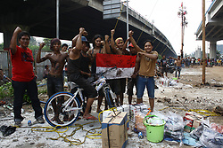 August 17, 2017 - Jakarta, Capital Region of Jakarta, Indonesia - The community is excited to participate in the 'Panjat Pinang' (Areca Pool Climbing), to commemorate Indonesia's 72nd Independence Day in Jakarta, August 17, 2017. 'Panjat Pinang' race is one of the typical race for Indonesian community in commemorating the day of Independence. This race is considered as a representation of hero's attitude that upholds unity, solidarity, and never give up in fighting for Independence. (Credit Image: © Aditya Irawan/NurPhoto via ZUMA Press)