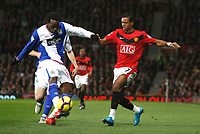 Photo: Steve Bond/Richard Lane Photography. Manchester United v Blackburn Rovers. Barclays Premiership 2009/10. 31/10/2009. Nani (R) has the ball taaken off his toe by Pascal Chimbonda
