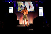 Chase Ferrel with Urban Carry Holsters displays a concealed hip holster during the National Rifle Association (NRA) Carry Guard Expo Fashion Show in Milwaukee, Wisconsin, U.S., August 25, 2017.   REUTERS/Ben Brewer