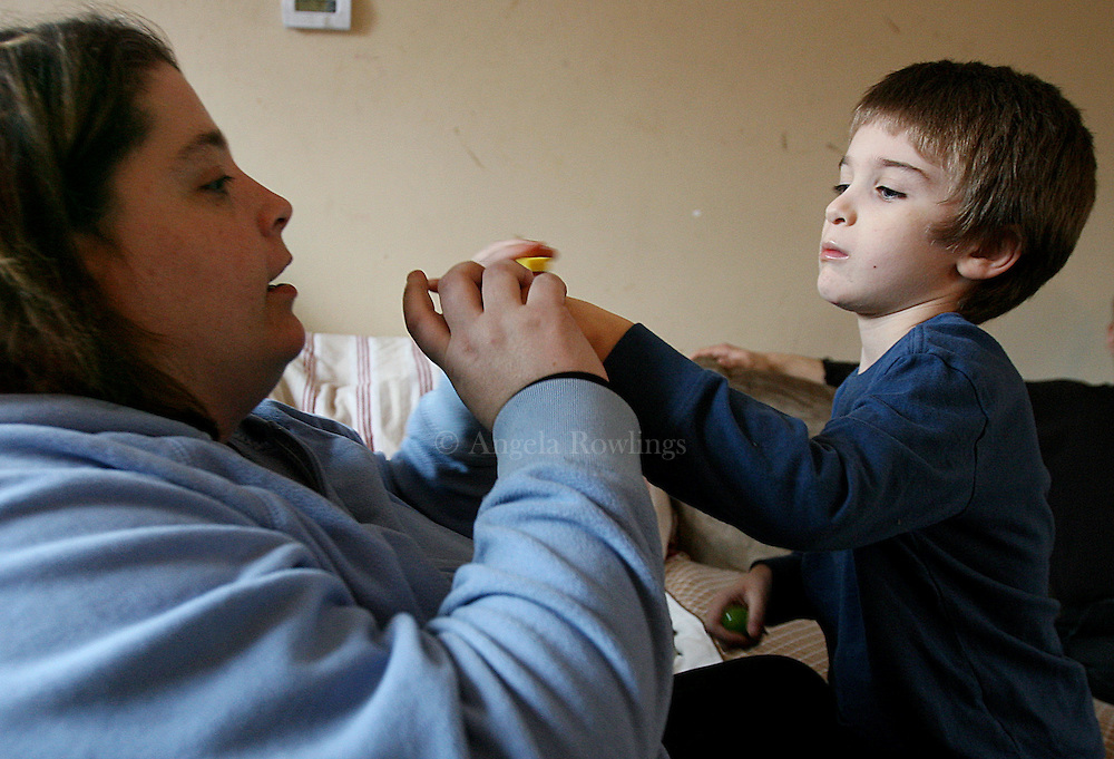 (013008  Boston, MA) Aidan Sumner, 4, works with his behavioral therapist, Megan McCorry, Wednesday,  January 30, 2008.  Aidan, who has lead poisoning, and his family being evicted from their Roslindale home where he contracted the lead poisoning.  Staff photo by Angela Rowlings.