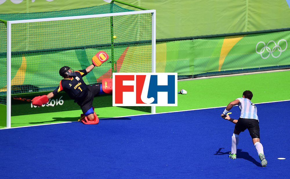 TOPSHOT - Argentina's Juan Gilardi scores a goal during the men's quarterfinal field hockey Spain vs Argentina match of the Rio 2016 Olympics Games at the Olympic Hockey Centre in Rio de Janeiro on August 14, 2016. / AFP / MANAN VATSYAYANA        (Photo credit should read MANAN VATSYAYANA/AFP/Getty Images)