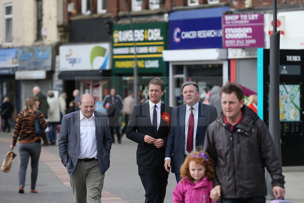 © Licensed to London News Pictures . 11/04/2015 . Bury , UK . Labour Shadow Chancellor Ed Balls and James Frith , Labour candidate for Bury North , at a campaign stop at The Rock shopping centre , Bury in Greater Manchester , UK . The pair met parents and discussed family finances . Photo credit : Joel Goodman/LNP