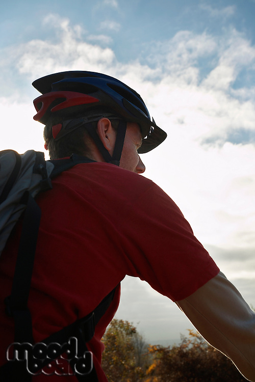 Mountain biker looking at view in countryside