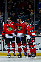KELOWNA, CANADA - MARCH 2: Josh Paterson #17, Jake Gricius #14 and Seth Jarvis #24 of the Portland Winterhawks celebrate a first period goal against the Kelowna Rockets  on March 2, 2019 at Prospera Place in Kelowna, British Columbia, Canada.  (Photo by Marissa Baecker/Shoot the Breeze)