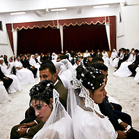 Brides and grooms prior to a mass wedding ceremony in Idku, Egypt. November 2007.