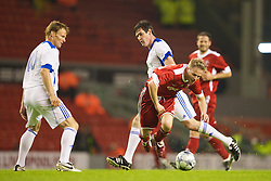 LIVERPOOL, ENGLAND - Thursday, May 14, 2009: Liverpool Legends' Nicky Byrne is fouled by All Stars' Mike Newell during the Hillsborough Memorial Charity Game at Anfield. (Photo by David Rawcliffe/Propaganda)