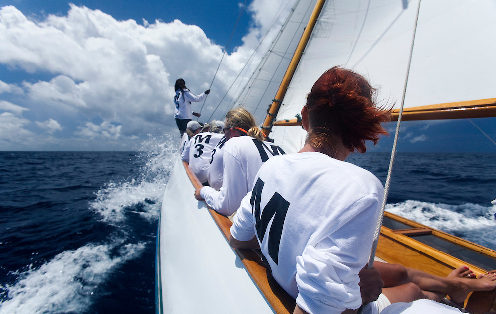 Crew on boats Galatea concentrate during the 2008 Antigua Classic Yacht Regatta . This race is one of the worlds most prestigious traditional yacht races. It takes place annually off the cost of Antigua in the British West Indies. Antigua is a yachting haven, historically a british navy base in the times of Nelson.