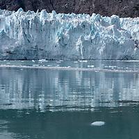 Margerie Glacier shows bright blue color on a sunny day. Glacier Bay National Park, Alaska