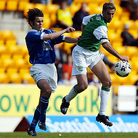 St Johnstone v Hibs   12.05.02<br />Craig Brewster outdoes Paul Hartley<br /><br />Pic by Graeme Hart<br />Copyright Perthshire Picture Agency<br />Tel: 01738 623350 / 07990 594431