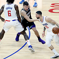 26 December 2017: LA Clippers guard Austin Rivers (25) drives past Sacramento Kings guard Bogdan Bogdanovic (8) on a screen set by LA Clippers center DeAndre Jordan (6) during the LA Clippers 122-95 victory over the Sacramento Kings, at the Staples Center, Los Angeles, California, USA.