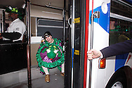 PHILADELPHIA - JANUARY 1:   A members of the Froggy Carr Comic Brigade catches a ride on a bus during the 105th Annual Mummers Parade January 1, 2006 in Philadelphia. Thousands lined the three mile parade route to watch Philadelphia's colorful New Years Day tradition, which dates back to 1900. (Photo by William Thomas Cain/Getty Images)