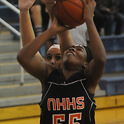 New Hanover's Nyasia Waddell shoots over Hoggard's Aleah Thompson Friday December 12, 2014 at Hoggard High School in Wilmington, N.C. (Jason A. Frizzelle)