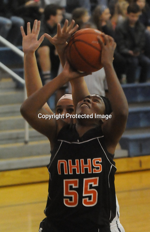 New Hanover's Nyasia Waddell shoots over Hoggard's Aleah Thompson Friday December 12, 2014 at Hoggard High School in Wilmington, N.C. (Jason A. Frizzelle)