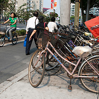 Bicycles stacked in a row in Shanghai, China
