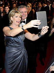 Eamonn Holmes with Ruth Langsford arrives at The National Television Awards Ceremony 2014, The O2 Arena, Greenwich,  London, United Kingdom. Wednesday, 22nd January 2014. Picture by i-Images