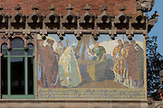 Mosaic by Mario Maragliano after designs by Francesc Labarta, of the origins and building of the Hospital de la Santa Creu in 1401, on the facade of the Administration Pavilion, built 1905-10, at the Hospital de Sant Pau, or Hospital de la Santa Creu i Sant Pau, built 1902-30, designed by Catalan Modernist architect Lluis Domenech i Montaner, 1850-1923, in El Guinardo, Barcelona, Catalonia, Spain. The original medieval hospital of 1401 was replaced with this complex in the 20th century thanks to capital provided in the will of Pau Gil. The hospital consists of 27 pavilions surrounded by gardens and linked by tunnels, using the Modernist Art Nouveau style with great attention to detail. On the death of the architect, his son Pere Domenech i Roura took over the project. The complex was listed in 1997 as a UNESCO World Heritage Site. Picture by Manuel Cohen