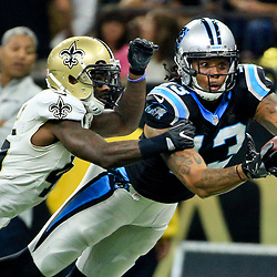 Oct 16, 2016; New Orleans, LA, USA; Carolina Panthers wide receiver Kelvin Benjamin (13) is unable to hold on to a reception as New Orleans Saints cornerback Ken Crawley (46) defends during the first quarter of a game at the Mercedes-Benz Superdome. Mandatory Credit: Derick E. Hingle-USA TODAY Sports