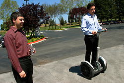 MOUNTAIN VIEW, CALIF., APRIL 8, 2003--GOOGLE-- Larry Page, Co-Founder & President, Products (L) and Sergey Brin, Co-Founder & President, Technology ( on his Segway Human Transporter) at Google's campus headquarters in Mountain View, Calif. They founded the company in 1998.  Photo by Kim Kulish