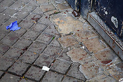 © Licensed to London News Pictures. 16/11/2015. Paris, France. Blood stains left on a pavement near Bataclan Cafe in Paris, France following the Paris terror attacks on Monday, 16 November 2015. Photo credit: Tolga Akmen/LNP