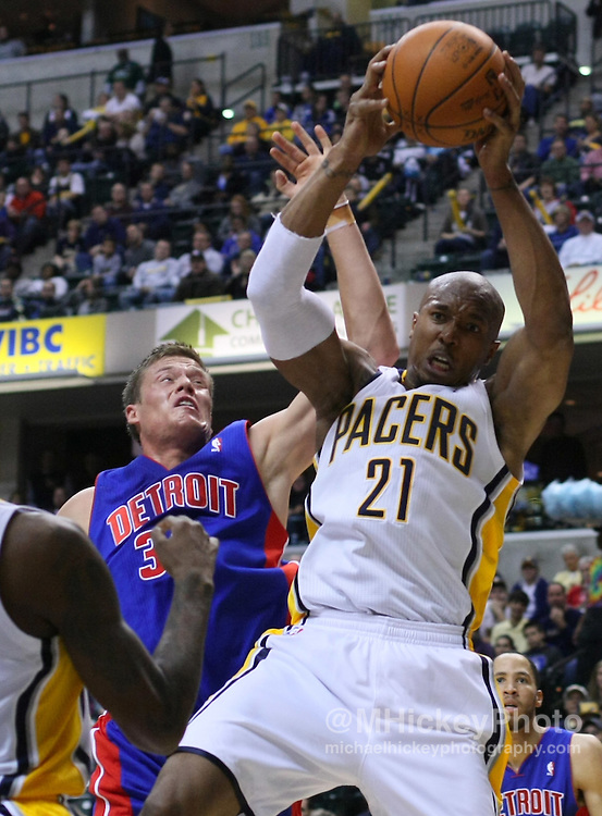 """Dec. 26, 2011; Indianapolis, IN, USA; Indiana Pacers power forward David West (21) battles for a rebound against Detroit Pistons forward Jonas Jerebko (33) at Bankers Life Fieldshouse. Mandatory credit: Michael Hickey-US PRESSWIRE <a href=""""mailto:michael.hickey@me.com"""">Email Me</a>"""