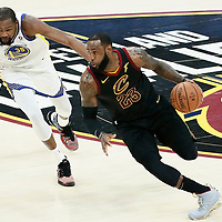 CLEVELAND, OH - JUN 3: LeBron James #23 of the Cleveland Cavaliers drives past Kevin Durant #35 of the Golden State Warriors in Game Three of the 2018 NBA Finals won 110-102 by the Golden State Warriors over the Cleveland Cavaliers at the Quicken Loans Arena on June 6, 2018 in Cleveland, Ohio. NOTE TO USER: User expressly acknowledges and agrees that, by downloading and or using this photograph, User is consenting to the terms and conditions of the Getty Images License Agreement. Mandatory Copyright Notice: Copyright 2018 NBAE (Photo by Chris Elise/NBAE via Getty Images)