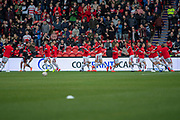 Doncaster Rovers players warm up ahead of the The FA Cup 5th round match between Doncaster Rovers and Crystal Palace at the Keepmoat Stadium, Doncaster, England on 17 February 2019.