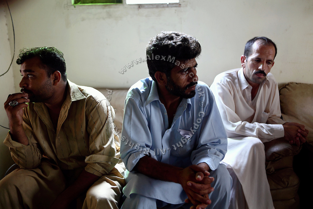 Truck drivers belonging to a Karachi-based company are sitting in their office. The company has been contracted by NATO to transport containers arriving to Karachi by ship to Afghanistan and other bases of NATO bases in the region. Many drivers have been killed on Afghan territory by insurgent's bandit attacks aimed at disrupting NATO's supplies. Some travel as far as Bagram Airfield, near Kabul, the Afghan capital.