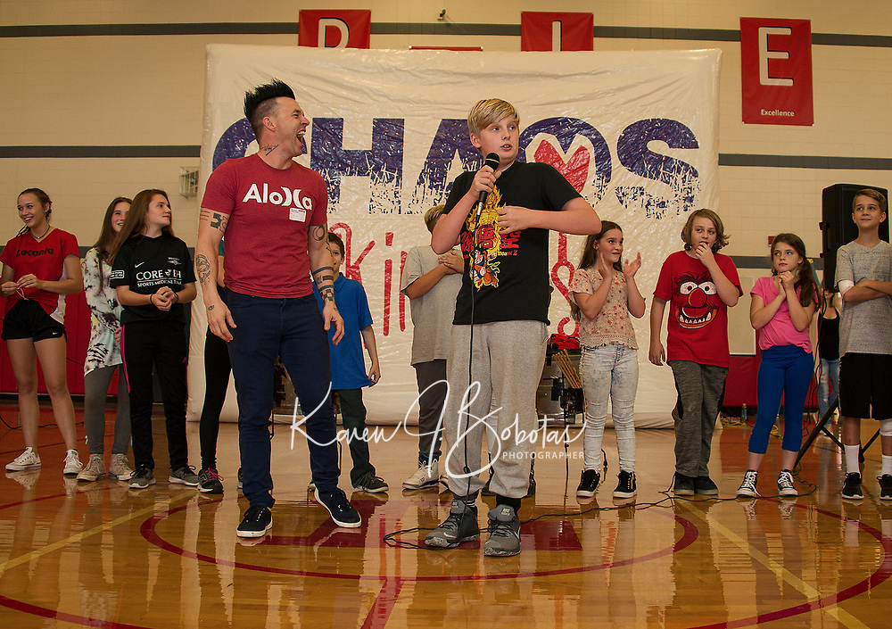 Cole gets a laugh out of Justin Spencer with his POTUS impersonation in the talent show during Recycled Percussion's takeover at Laconia Middle School Thursday afternoon.  (Karen Bobotas/for the Laconia Daily Sun)