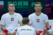 (L) Marcin Matkowski &amp; (R) Mariusz Fyrstenberg both from Poland rest while men's double during the BNP Paribas Davis Cup 2013 between Poland and Australia at Torwar Hall in Warsaw on September 14, 2013.<br /> <br /> Poland, Warsaw, September 14, 2013<br /> <br /> Picture also available in RAW (NEF) or TIFF format on special request.<br /> <br /> For editorial use only. Any commercial or promotional use requires permission.<br /> <br /> Photo by &copy; Adam Nurkiewicz / Mediasport