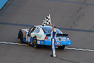 Nov. 14, 2009; Avondale, AZ, USA; NASCAR Nationwide Series driver Carl Edwards celebrates after winning the Able Body Labor 200 at Phoenix International Raceway. Mandatory Credit: Jennifer Stewart-US PRESSWIRE