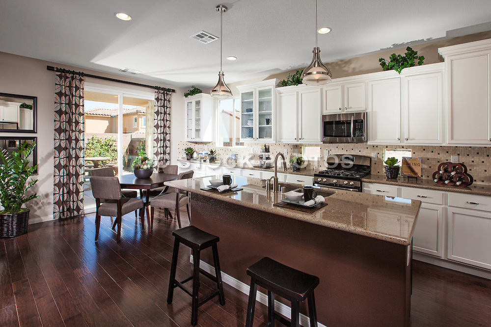 White Kitchen Cabinets and Dark Brown Wood Floors