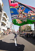"A participant waves an flag while taking part in a parade during the Kanamara ""Penis"" Festival in Kawasaki, Japan."