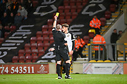 Jake Taylor of Port Vale FC recieves a yellow card during the EFL Sky Bet League 2 match between Bradford City and Port Vale at the Utilita Energy Stadium, Bradford, England on 22 October 2019.