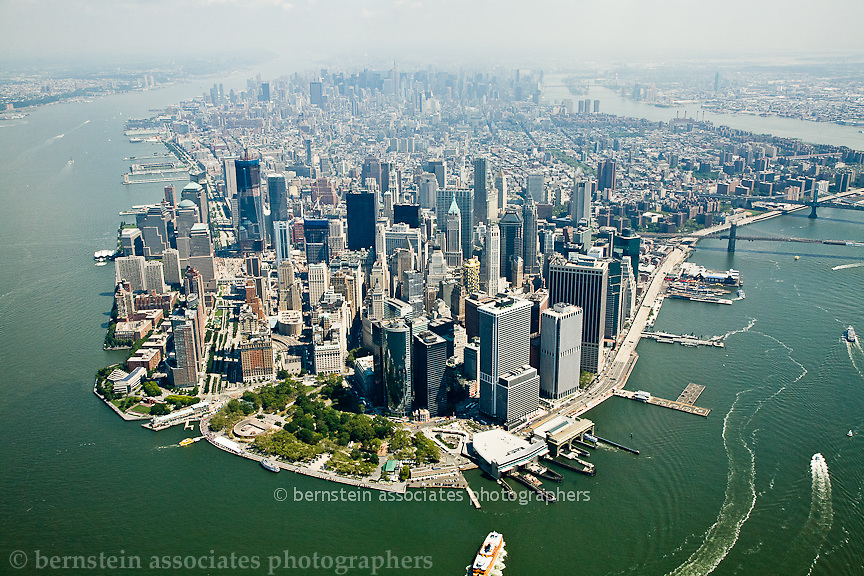 Aerial photos of the lower Manhattan skyline.  Battery Park, East River and Hudson River.