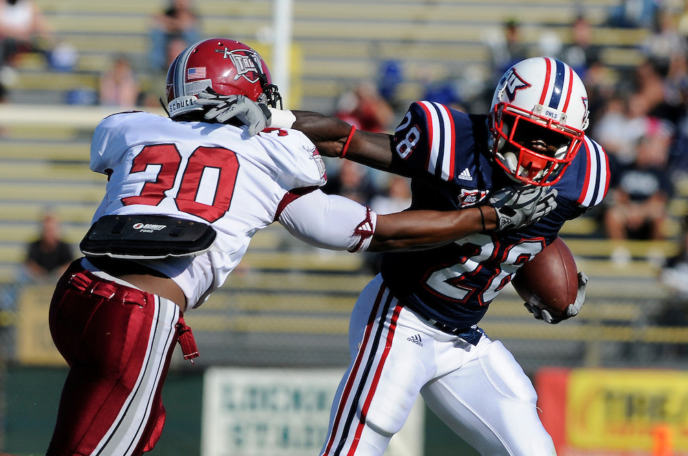 December 4, 2010: LaDarrius Madden of the Troy Trojans tries to tackle Willie Floyd of the Florida Atlantic Owls during the NCAA football game between Troy and FAU. The Trojans defeated the Owls 44-7.