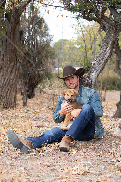 good looking cowboy with an adorable puppy