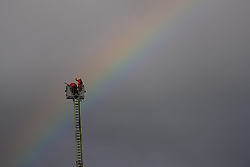 """© Licensed to London News Pictures. 16/11/2019. Bolton, UK. A rainbow is seen over The Cube as firefighters work at the scene where a fire broke out overnight (15th/16th November 2019) at a block of flats known as """" The Cube """" , in Bolton Town Centre . At least two people are known to have been treated by paramedics at the scene of the six-story , block which is occupied by students of the University of Bolton . Photo credit: Joel Goodman/LNP"""