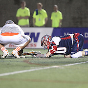 Stephen Berger #10 of the Boston Cannons falls to the ground during the game at Harvard Stadium on May 10, 2014 in Boston, Massachusetts. (Photo by Elan Kawesch)