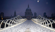 A multi-image composite of London's Millenium Bridge under a dusting of snow. Built as part of the year 2000 celebrations, the bridge connects St. Pauls Cathedral on the North Bank of the Thames, with the Tate Modern Gallery on the South.