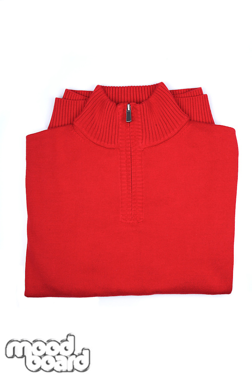 Red sweater on white background