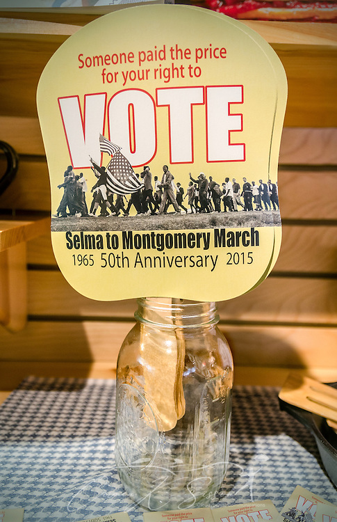 "Paper fans encouraging people to vote and commemorating the 50th anniversary of the Selma to Montgomery march are displayed inside a mason jar at Lowndes Interpretive Center, Feb. 3, 2015, in Hayneville, Ala. Dallas County Sheriff Jim Clark, Alabama state troopers, and newly deputized local citizens attacked civil rights demonstrators attempting to cross Selma's Edmund Pettus Bridge, March 7, 1965. More than 60 protesters were hospitalized due to their injuries, and the day became known as ""Bloody Sunday."" The violent confrontation marked a pivotal turning point in the Civil Rights movement.  On March 21, 1965, activists crossed the Edmund Pettus Bridge and marched 54 miles to the Alabama State Capitol in Montgomery. The Voting Rights Act was passed, Aug. 6, 1965, outlawing poll taxes, literacy tests, and other methods used to prevent blacks from voting. (Photo by Carmen K. Sisson/Cloudybright)"