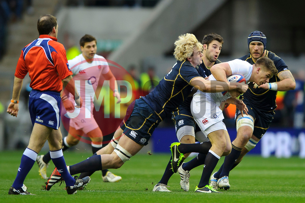 England Fly-Half (#10) Owen Farrell (Saracens) is tackled by Scotland Lock (#4) Richie Gray (Sale Sharks) during the first half of the match - Photo mandatory by-line: Rogan Thomson/JMP - Tel: Mobile: 07966 386802 02/02/2013 - SPORT - RUGBY UNION - Twickenham Stadium - London. England v Scotland - 2013 RBS Six Nations Championship. The winner of this fixture is awarded the Calcutta Cup.