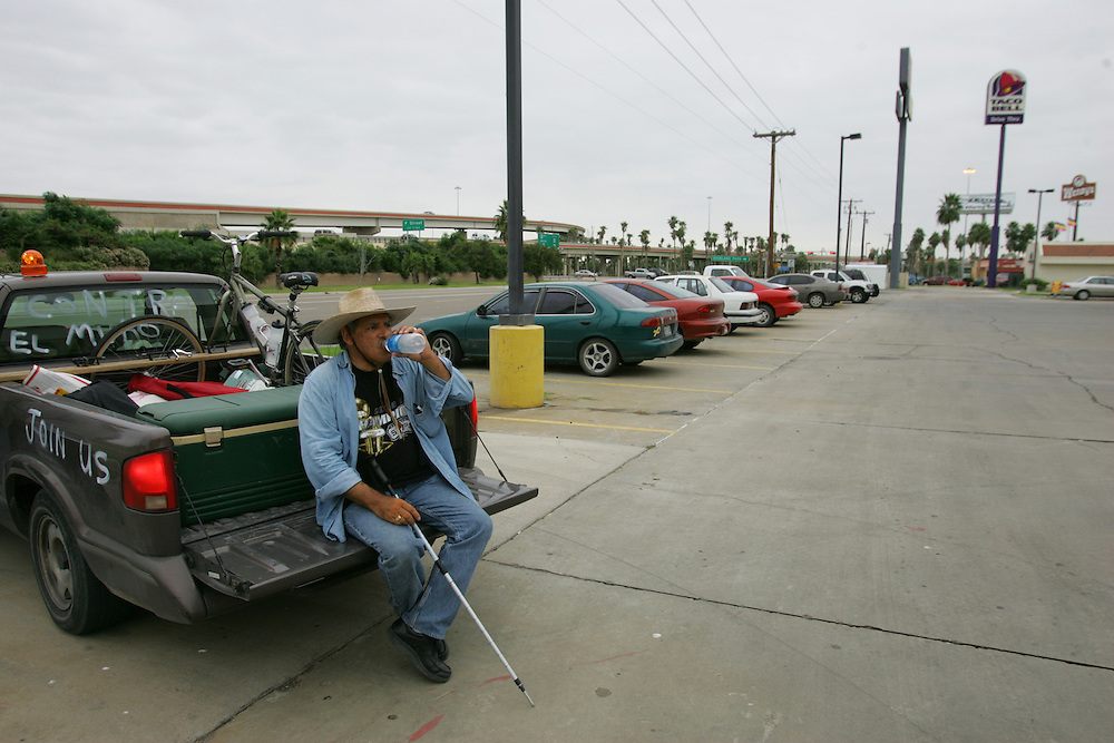 At the end of day 14 of his protest walk, Jay Johnson Castro stops to take a drink in Harlingen.