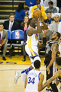 Golden State Warriors forward Draymond Green (23) shoots a floater against the San Antonio Spurs at Oracle Arena in Oakland, Calif., on October 25, 2016. (Stan Olszewski/Special to S.F. Examiner)