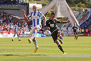 Brentford  defender Nico Yennaris (8)  with a shot during the EFL Sky Bet Championship match between Huddersfield Town and Brentford at the John Smiths Stadium, Huddersfield, England on 6 August 2016. Photo by Simon Davies.