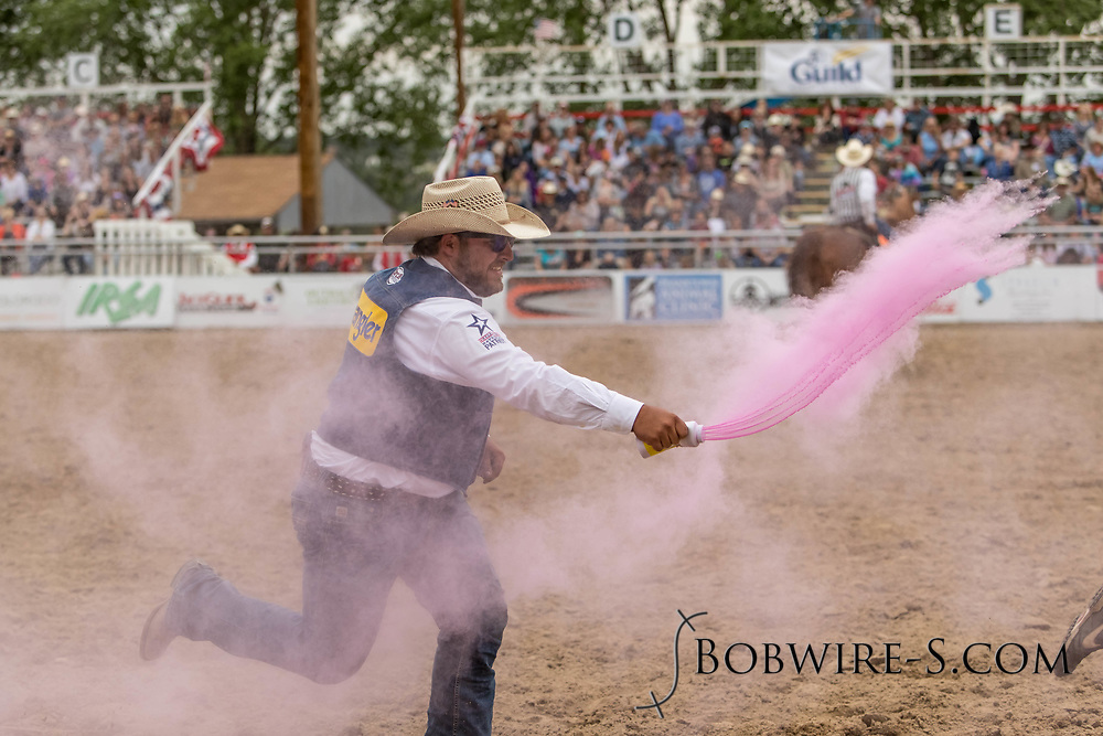One of the volunteers tries to get back at barrelman JW Winklepleck for JW's earlier antics during the third performance of the Elizabeth Stampede on Sunday, June 3, 2018.