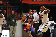 """SMU's London Giles (11) vs. Ole Miss' Jarvis Summers (32) at the C.M. """"Tad"""" Smith Coliseum in Oxford, Miss. on Tuesday, January 3, 2012. Ole Miss won 50-48."""